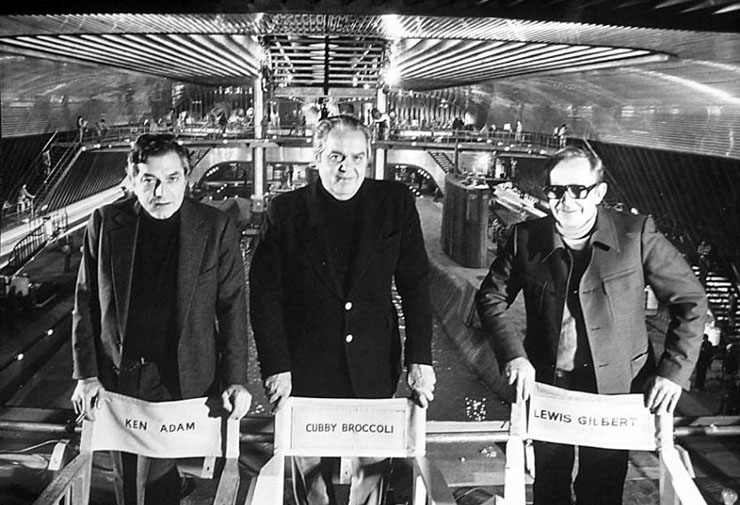 Ken Adam with produer Albert R. 'Cubby' Broccoli and Director Lewis Gilbert on the Liparus supertanker set built in the 007 Stage at Pinewood Studios for The Spy Who Loved Me (1977).