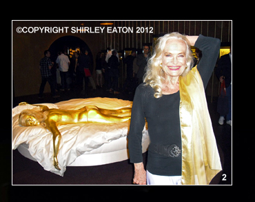 Shirley Eaton with recreation of the golden girl from Goldfinger (1964)
