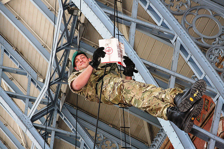 Royal Marines Commandos abseiled from St. Pancras Station's famous listed roof to deliver the first public copies of CARTE BLANCHE